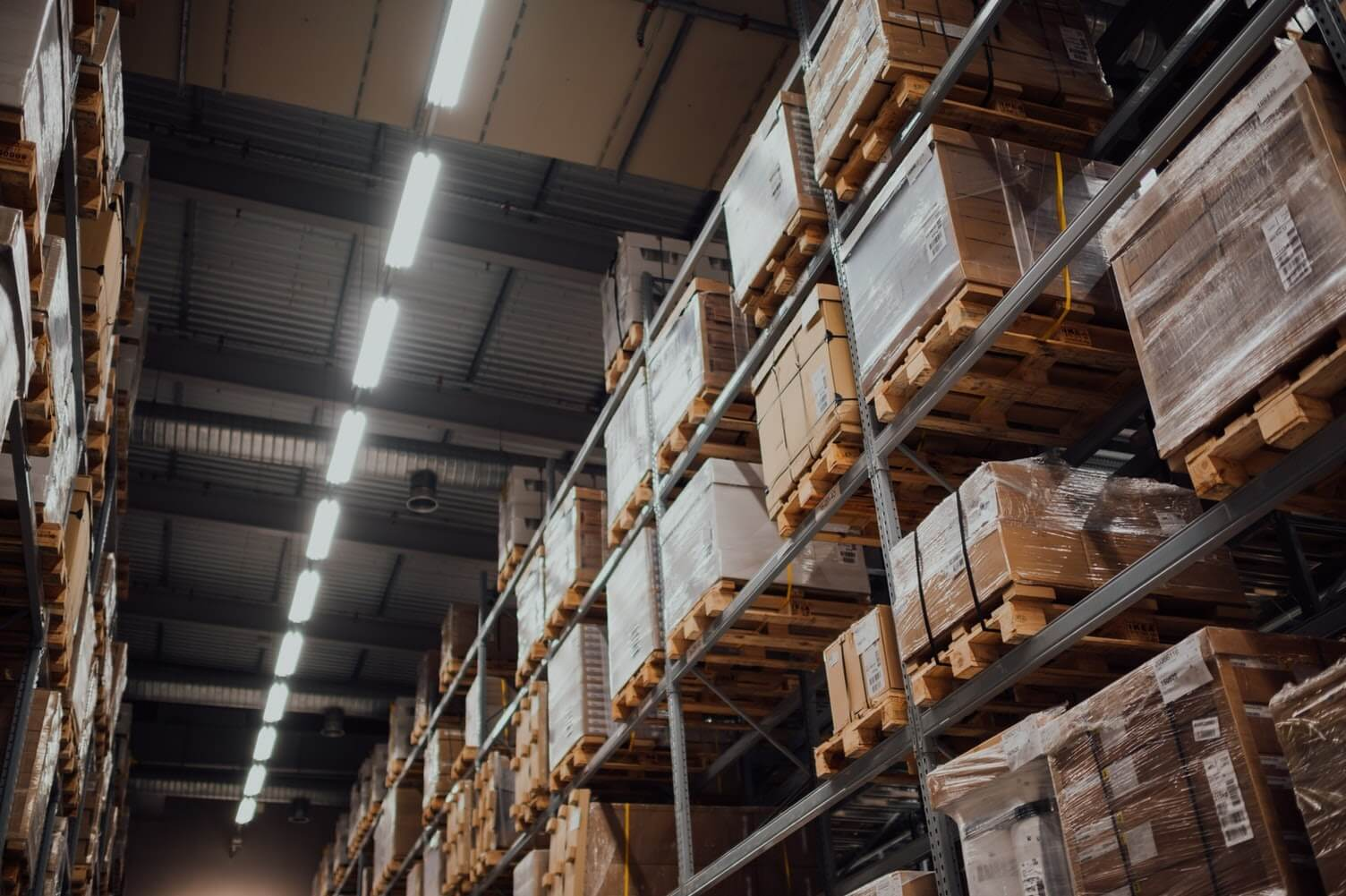 A photo of inventory boxes within a warehouse.
