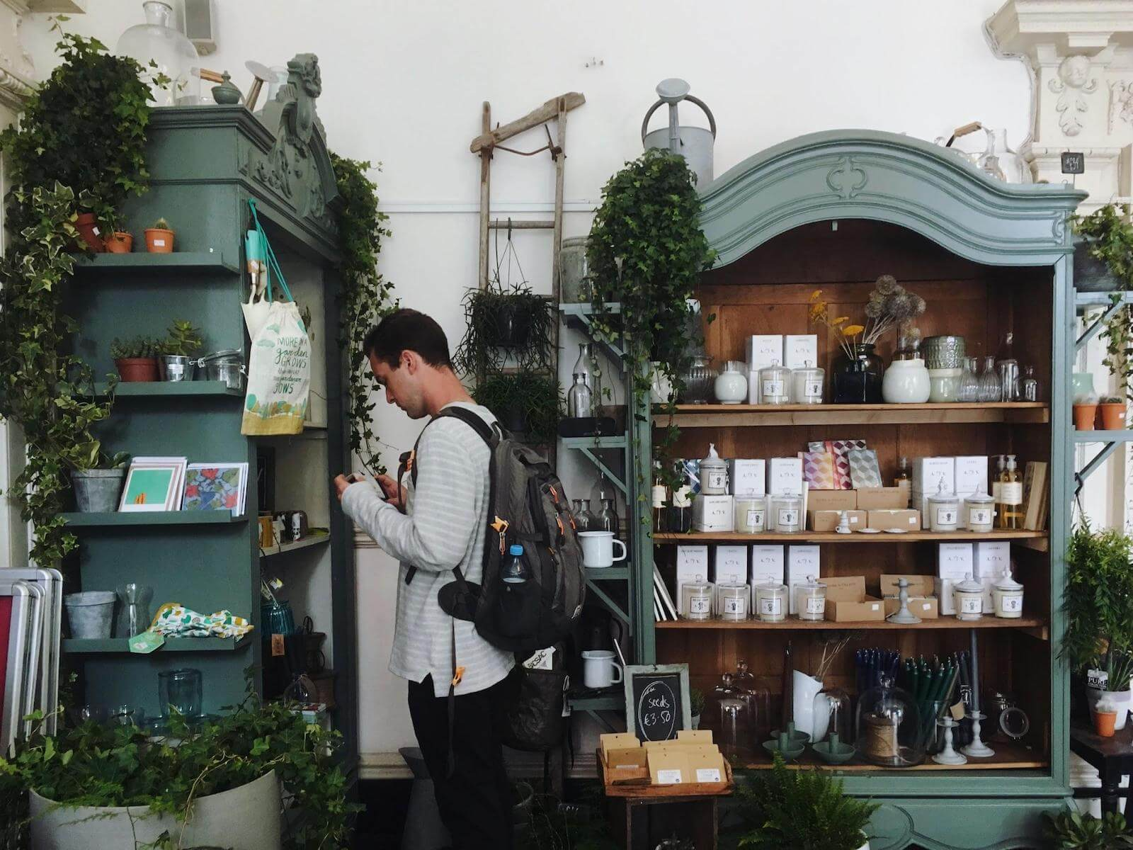 Multi Channel Inventory Sync: A photo shows a beautiful boutique with plants, handmade cards, candles, and miscellaneous goods for your home.